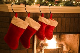 Christmas stockings hung over fireplace
